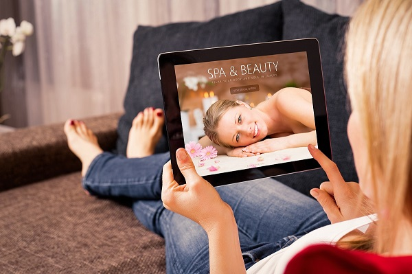 A person using Medical Spa Software on their tablet